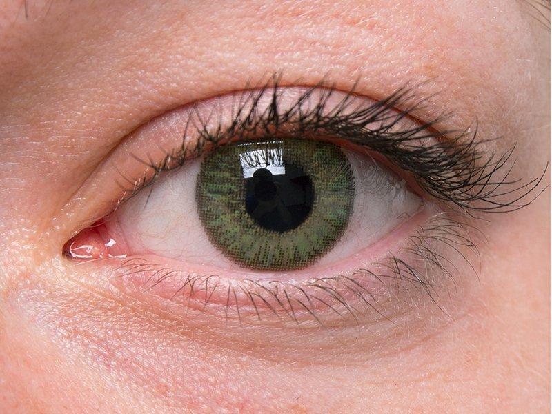 Green na šedom oku
